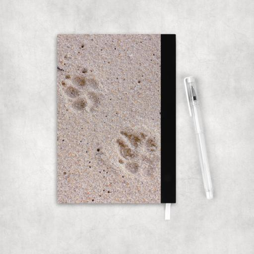 Notebook back paw prints.png